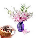Delicious 1 Kg. Black Forest Cake with 12 stems of Orchids in a vase is the gift for the season. The cake is made of fresh cream and topped with cherries and the Orchids are a sheer treat to the eyes. Long after the flowers are gone, the vase can be used for multiple purposes.