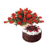 Lovely 24 red roses and a fresh creamy black forest cake is the choice for all  occasion.