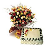 Sumptouus 1 kg pinapple cake with cheerful lovely mix colour roses hand tied in a lovely prim crepe with a flowing bow.
