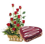 Lovely combination of sumptuous 1 Kg Heart Shaped Chocolate Cake with a Basket full of 15 Red Roses.