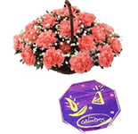 Exotic carnations with a pack of cadbury\'s chocaltes is the best way to bring smile on someone\'s face.