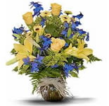 This cheerful arrangement of yellow roses, blue delphinium, Asiatic lilies, yellow pompons and solidago - will definitely bright somebody\'s day.