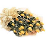 24 Yellow Roses with greens arranged in a bunch with a bow.