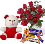 A 6 inch teddy with a bunch of 12 Roses and a box of Celebration Chocolates
