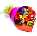 In the groove a bright, beautiful selection of seasonal flowers. Three Gerberas, two Lilliums and eight Roses.