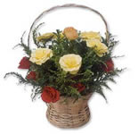 The natural beauty of bamboo adds to the splendor of this arrangement. A bunch of twelve yellow and red roses arranged with lots of green leaves to make it look refreshingly beautiful.