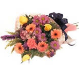An Exclusive Arrangement of 8 Red Gerberas, 8 Peach roses and 8 Pink Roses with Greenary.