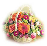 Gerberas and Roses in a round Basket.