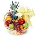 Arrangement of Fresh Fruits in a cane basket. (1.5 Kg. of Fresh Seasonal fruits.)<br> Fruit selection will depend on Seasonal Availibility.