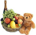 Send an arrangement of Fresh Fruits in a cane basket. 4 Kgs. of Fresh Seasonal fruits with 1 litre of Fruit Juice with a cute teddy (Height :6 Inches) .<br>Fruit selection will depend on Seasonal Availability.